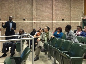 Community members discuss plans for Young Men's College Preparatory Academy at a meeting Thursday night at the school.