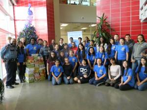 Members of HISD PD and Carnegie Vanguard High School's Interact Club
