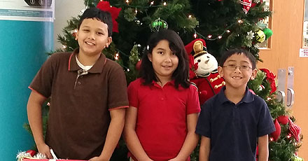 Park Place students won big in the national Bing Summer Story Challenge. From left to right are Adrian Pizarro, Johana Contreras Castillo, and grand prize winner Shaun Toliao.