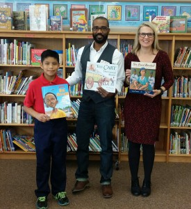 Red ES student Brian Mejia poses for a photo with children author Don Tate and the school librarian, Melissa Buron.