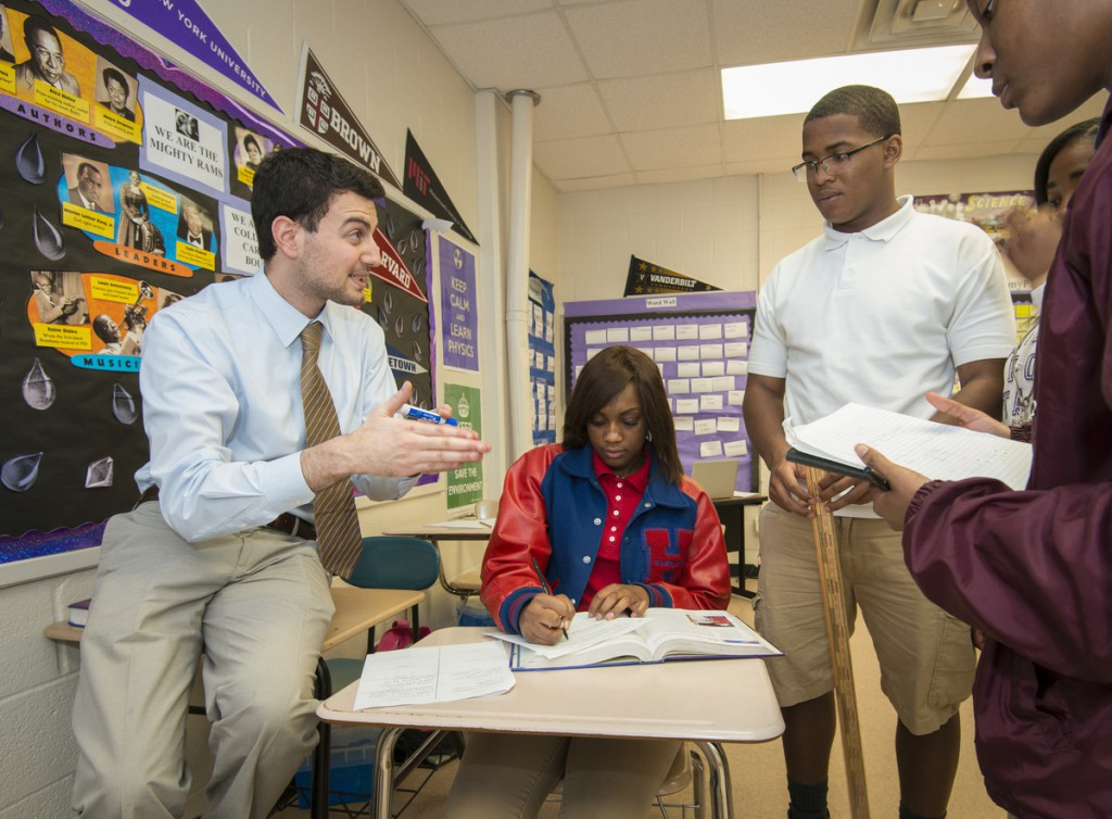 Physics teacher Adeeb Barqawi works with his students at Kashmere High School.
