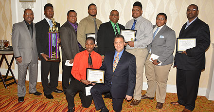 HISD representatives accept good sportsmanship awards on behalf of Austin, Davis, North Forest, Sterling, and Yates high schools at the Touchdown Club's annual luncheon Jan. 28.