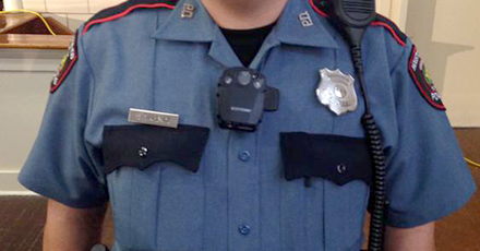 An HISD police officer wears one of the body cameras being tested this month.