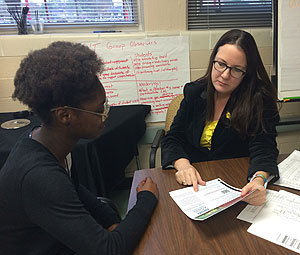 Dean of Students Tiphaine Shaw works with Furr HS student Javeona Sudduth.