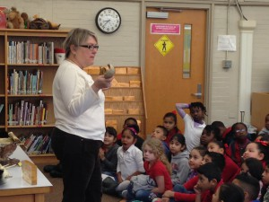 Anne Eisner from the Nature Discovery Center acquaints Red ES STEM magnet students with wildlife.