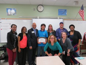 Front row (L to R): Elizabeth Bandercan, German Lerma's soccer coach at Johnston, and one of his teachers, Kristen Aust. Back row (L to R): Rainatu Gabisi, Yolanda Guillory, and Sid Evans from Reliant; winner German Lerman; nominating teacher Lanena Berry; Johnston teacher William Aust; and Johnston MS Assistant Principal Claran Johnson.