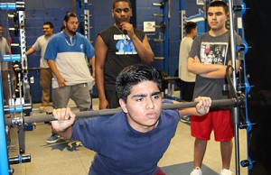Chávez freshman Edwin Alas lifts weight after school.