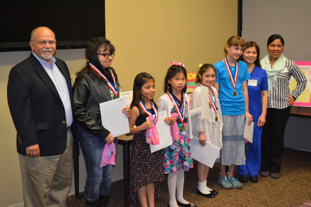 From left: Dr. Piazza, president of the Greater Houston Dental Society; Piney Point ES fifth-grader Viviana Jimenez; Garden Villas ES third-grader Alejandra Rodriguez; White ES second-grader Sandy Kong; Condit ES fifth-graders Eden Barr and Heidi Tamm; CoChairs of the Dental Health Committee Dr. Nguyen and Dr. Aguilos.