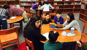Students from North Houston Early College High School read to second-graders at Roosevelt Elementary School.