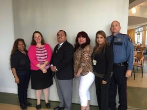 (From left to right): Maria J. Smith, Kathy Sterbanz, Leo Bobadilla, Loretta Galaviz, Delia Garcia and Officer Rick Evans