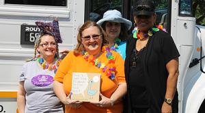 Librarians Alice Hedstrom (Almeda ES), Cheryl Hensley (MacGregor ES), and Jo Ann Reed (Scroggins ES) and Library Specialist Gloria Dennis get ready to take the bookmobile on the road. Photo courtesy Muses3, LLC.