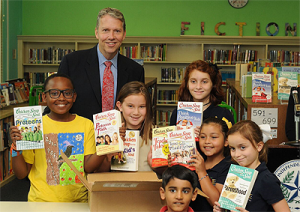 Students at Poe ES pose with Principal Jeff Amerson and their new books.