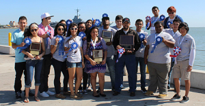 Lee High School students—many of whom worked on the greenhouse project—pose with their trophies from the Texas SkillsUSA State Championships this year. Johnny Brooks' millwork and cabinetry students routinely advance to the state level of the competition.