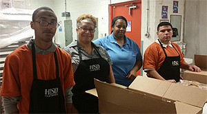 Waltrip High School students work at Garden Oaks Montessori with their transition coach and the Garden Oaks cafeteria team lead.