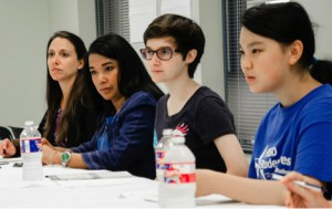 Audene Chung and Amanda Oceguera listen to HISD's Student Congress Representatives request to help less fortunate Houstonians.