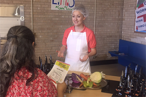 Dietitian Jennifer Griffin Lengyel advices a parent during a community outreach event at Elrod Elementary School.