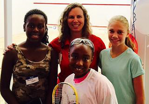 Principal Angela Sugarek celebrates the opening of new squash courts at Hogg MS with some of her students on Aug. 29.