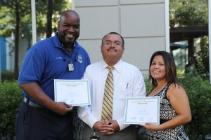 From left to right: Curtis Harris, Chief Operating Officer Leo Bobadilla and Monica Cruz. Not pictured: Officer Quentin Wilson.