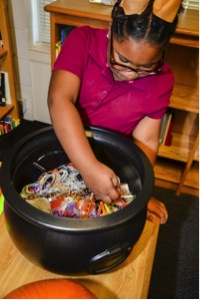 Stevens Elementary School student Ke'Oshia Johnson picks up a treat during healthy Halloween class.