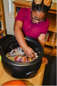 Stevens Elementary School student Ke'Oshia Johnson picks up a treat during healthy Halloween class.