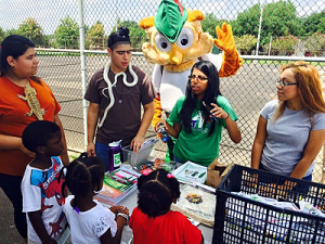 Green Ambassadors visit local schools, communities, and parks to spread the conservation and environmental awareness message. They work with Woodsy Owl and his animal friends.