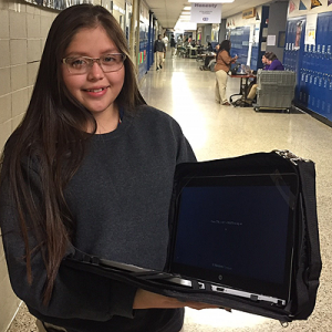 Washington HS sophomore Karla Bueno displays her new laptop.
