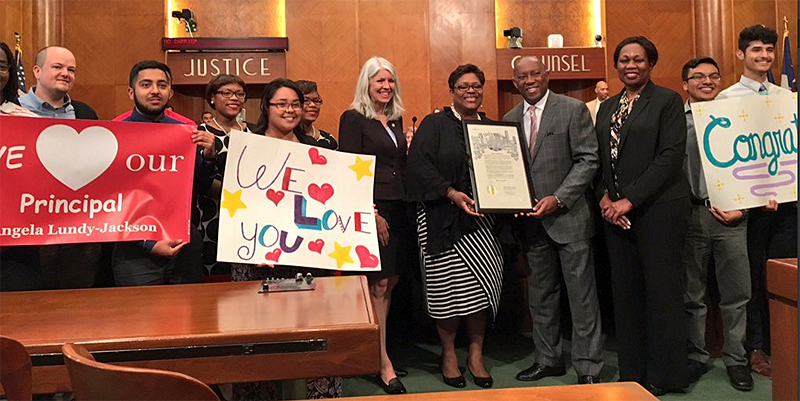 NHECH Principal Angela Lundy-Jackson (striped skirt) is recognized by Houston City Councilwoman Karla Cisneros (left center) and Houston Mayor Sylvester Turner (right center) on Feb. 23.