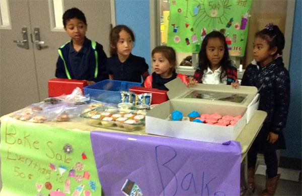 Briarmeadow Charter School students raised enough money at this bake sale to buy prosthetic limbs for two Cambodian amputees.