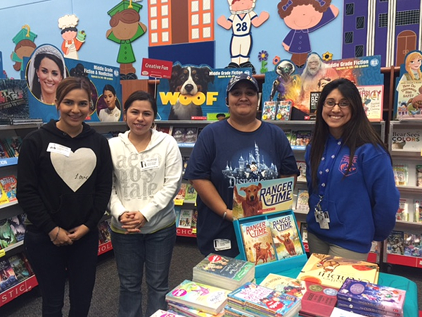 DeAnda ES parents (pictured) were able to purchase books at discounted prices from local retailers after obtaining library cards from the Houston Public Library, thanks to a special arrangement made by Principal Erwin Garcia Velazquez.