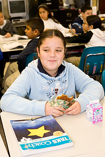 A student at Jackson Middle School enjoys breakfast at her desk through the First Class Breakfast program.
