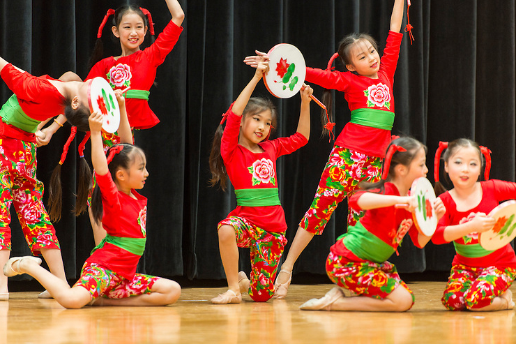 Students at Kolter ES perform during a 2015 Lunar New Year celebration.