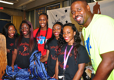 HISD alumnus Moran Norris regularly gives back to the schools he attended, including Madison High School (pictured). Here, he is distributing backpacks to incoming freshmen during the fall 2015 orientation.