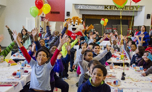Kennedy ES students enjoy a pizza party after achieving 100-percent participation in HISD's breakfast program.