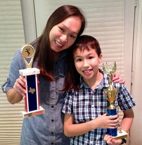 Lovett ES fifth-grader Bryan Moore poses with his mother, Tonyamas Moore, who won the spelling bee at that campus back in 1986.