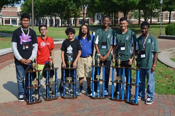 Mickey Leland Preparatory Academy's middle-school and high-school teams at the SECME VEX nationals with SECME staffer Anthony Bowser. Students (left to right) are Evert Guzman, Brandon Chuor, Danny Medina, Anthony Bowser, Marcellus Jordan, Luis Torres, and Jarmel Brown.